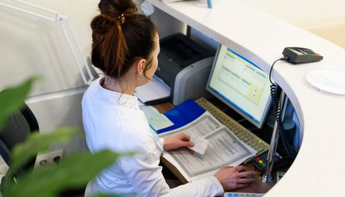 Express Securities receptionist working.